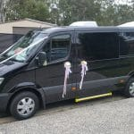 Mercedes-Black-Sprinter-Wedding-Side-Flowers