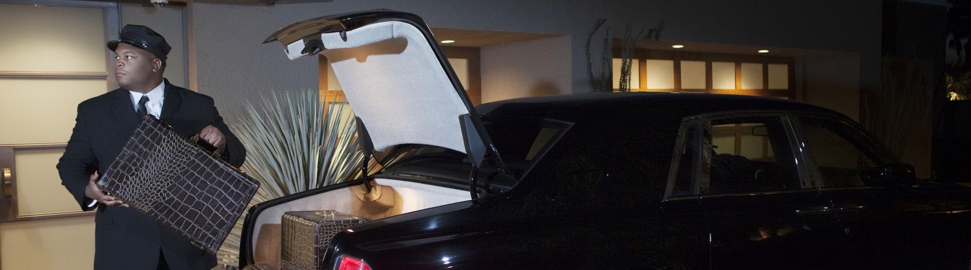 Chauffeur Loading Luggage In Car